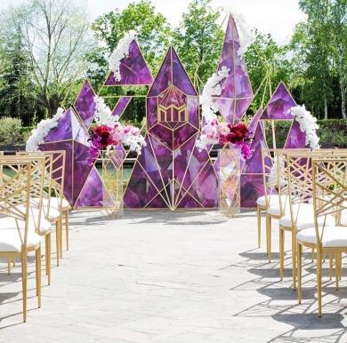 Geometric Ceremony Backdrop with Gold Geo Chiavari Seating