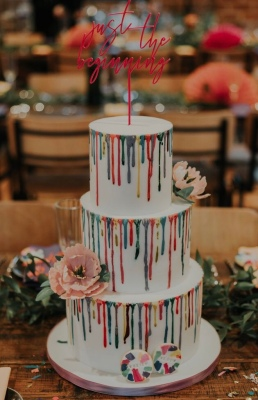 Tiered cake with dripping paint detail