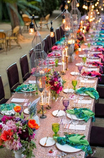 Use colorful napkins and rainbow florals to brighten up the reception